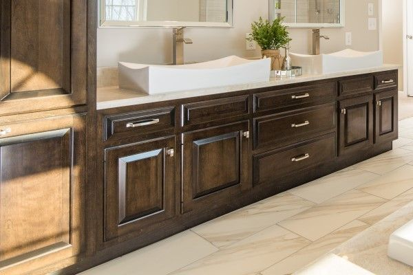 Master bath with custom birch cabinets in dark coffee stain.