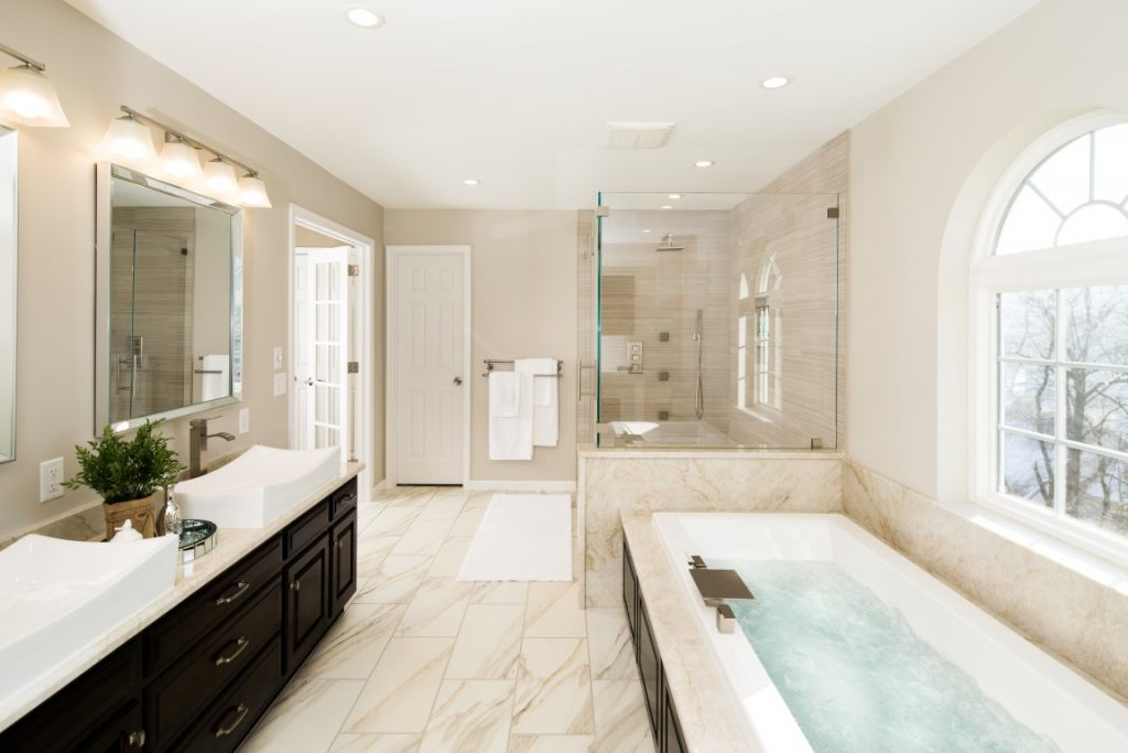 Custom master bath features Quartzite tub platform top and countertops