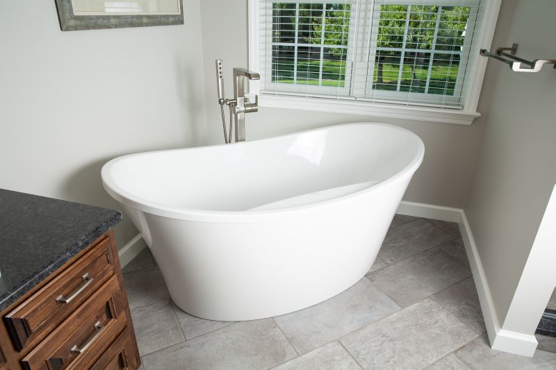 Free-standing, white soaking tub.