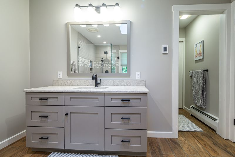 Gray vanity with Quartz top.